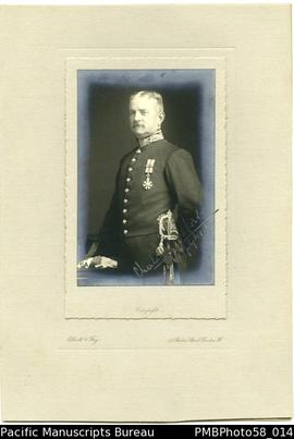 Portrait of C.M.Woodford, wearing the order of St.Michael and St.George medal, 6 Jul 1916 (facing...