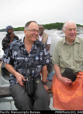 [Chris Gregory [left] and Bill Gammage [right] enroute to Bau with Emogi/Emosi Qelo and unknown]