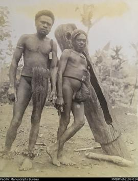 'Ankle bells and old dumdum', two men with wooden slit drum, Big Nambas area, Malekula
