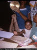 """29. Tralimbuwa, M.C.H. clinic staff nurse, with daughter Agnes - weighing a baby in clinic ..."