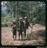 """Jack Layowa with old man, his wife and pussy on way to caves. Jack was our guide, and schiz..."