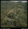 """Kompian mission station -  up a mountainside. Baiyer lies many ridges beyond (behind). From..."