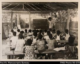 New Hebridean children learning to read and write, Lamenu, New Hebrides