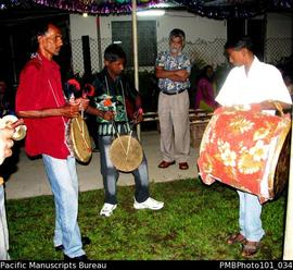 [Suva Wedding Two drummers using traditional instruments, playing at great speed.]