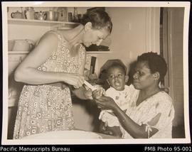 Mrs. Jessie Murray attending a small patient - Nguna