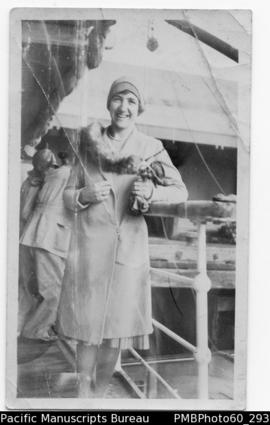 European woman standing on deck of ship