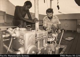 "John Cunningham and assistant checking engine of ""envoy"""