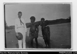 Mr Paton with three ni-Vanuatu boys