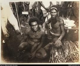 'Sitting on bundle of fencing-cane', unknown man with Chief Nisai (L-R), Big Nambas are...