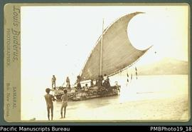 Mounted photograph of people in Papua New Guinean canoe with large sail.