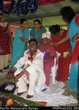 [Suva Wedding Mahen the groom dressed in wedding clothes with his mother (wearing his hat)  and o...