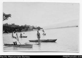 ni-Vanuatu Boys on local model canoes