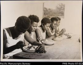 Ebuli hostel girls having their midday meal, Onesua
