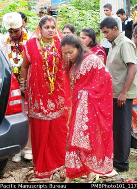 [Suva Wedding Savita taking a last sad look at her family home.  She is assisted by a bridesmaid,...