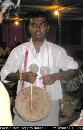 [Suva Wedding  Drummer using traditional instrument  playing at great speed]