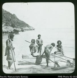Group with outrigger canoe