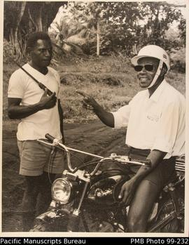 Pastor Silas on his motorbike stops to talk to Elder Gideon in a distant part of his parish.