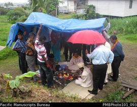 [Suva Wedding  The ceremony outside the bride's family home.  Bridegroom, priest, ?, guests ...