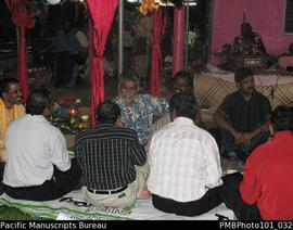 [Suva Wedding Guests in front of dais on which the band played.  Brij Lal in blue and white shirt.]