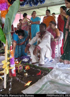 [Suva Wedding  Mahen the groom dressed in  wedding clothes and his mother (holding his hat) and o...