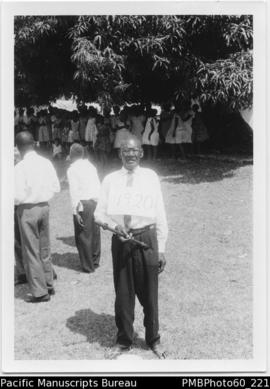 ni-Vanuatu male elder with labelled sign and sceptre