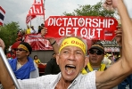 Anti-coup protesters march during a demonstration organised by allies of ousted premier Thaksin Shinawatra in Bangkok, 2007. Photo by AFP.
