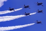 Japan Self Defence Force T-4 Blue Impulse fighter jets fly in formation. Photo by ARTS_FoxFire1 on Flickr.com