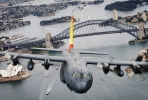 A C-130H Hercules A97-005 flies over Sydney Harbour. Image courtesy of Department of Defence.