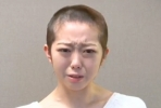 Minegishi Minami's tearful apology and new look hair. Image from YouTube.