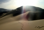 Trekking on the Singing Sands Mountain (Dunhaung, Gansu Province, China). Photo by Josh Leslie.