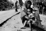 A Rohingya woman and young child. Photo by Greg Constantine.