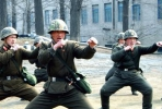 North Korean soldiers put their dukes up. Photo from AAP.