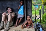 Australian sapper Jonathan Buttery sits with ni-Vanuatu children. Photo by Department of Defence on flickr.