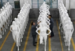 Workers go through a quality check for new made mannequins at the end of a Chinese factory's production line. China is now the world's second largest economy. Photo by mb+f on flickr