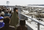 A woman looks over the devastation to Sendai after Japan's 3/11 disaster. Photo from flickr.