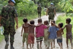UN peacekeeper with East Timorese children. Photo by UN Photo.