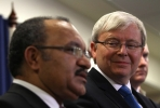 PNG prime minister Peter O'Neill and Kevin Rudd. Photo by AFP.