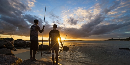 Image of fishermen silhouetted by sunset, supplied by Lirrwi Indigenous Tourism in Arnhem Land NT