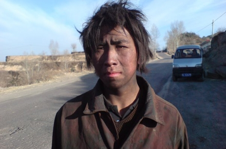 A young Chinese coal worker from Shanxi province, China. Photo by andi808 on flickr.