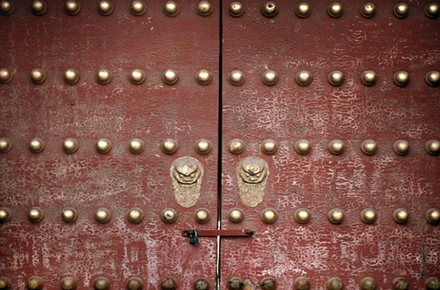 An ancient gate in Beijing's Forbidden City. Many Chinese peasants are being locked out of China's cities. Photo by Rob Sheridan on flickr.
