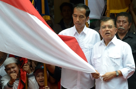 The announcement of the Jokowi and Kalla (right) ticket was as colourful as their shirts. Photo by AFP.