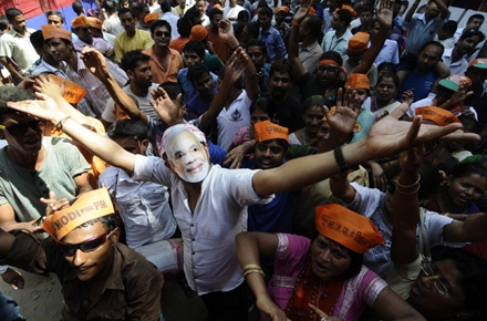 Suporters of Narendra Modi celebrate his victory in India's elections. Photo by AFP.