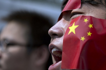 A Chinese national protests Japan's claims to the Diaoyu islands. Photo by AFP.