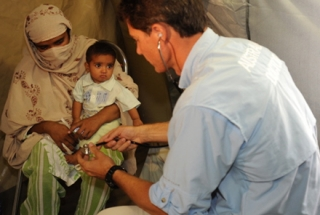 An Australian medic treats patients in Pakistan. Photo by Department of Defence on flickr.
