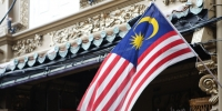 Malaysian flag flying outside a shop on Jonker street, Malacca, Malaysia