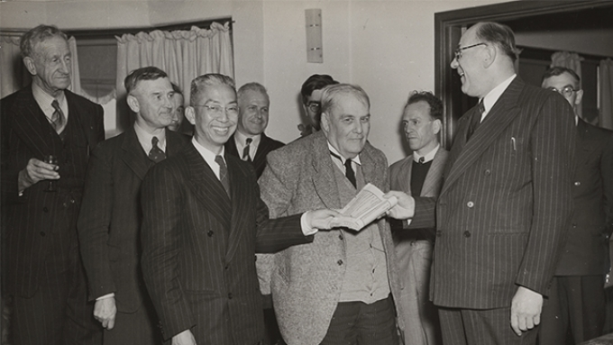 Members of the ANU Interim Council receiving a gift of Chinese books from Kan Nai-kuang, Chinese Ambassador to Australia, November 1948. From the left: Robert Garran, Charles Daley, Kan Nai-kuang, Leslie Martin, Frederic Eggleston, Roy Douglas Wright (behind Eggleston), Herbert Cole 'Nugget' Coombs and Douglas Copland. (Courtesy National Library of Australia).