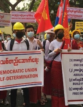 Protesters with masks in Myanmar