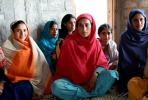 Pakistani women gather to talk about how to stop violence against women. Photo by uusc4all on flickr.