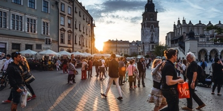 People walking in town square_Photo by Jacek Dylag on Unsplash