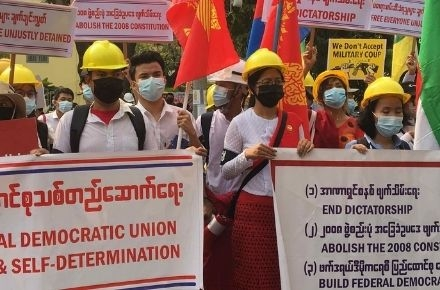 Protester with masks in Myanmar